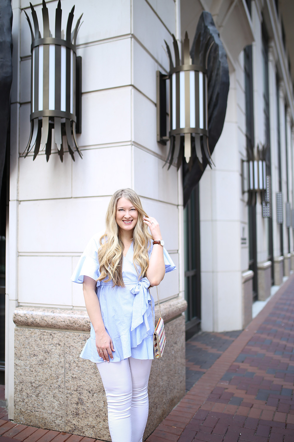 Dallas fashion blogger Cameron Proffitt wears Topshop wrap shirt with white jeans -- topshop shirt dress -- chelsea28 crossbody bag -- Topshop Wrap Top with Ruffled Edges