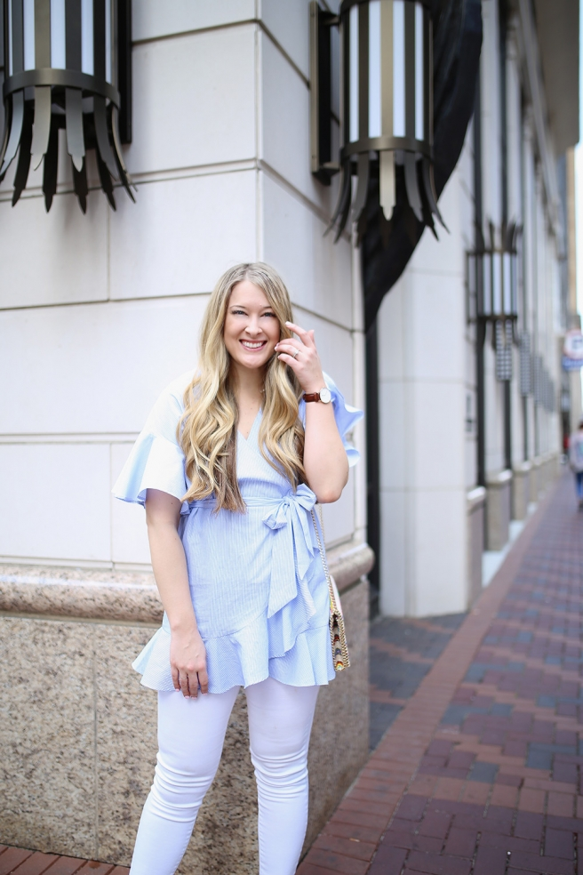 Dallas fashion blogger Cameron Proffitt wears Topshop wrap shirt with white jeans -- Topshop Wrap Top with Ruffled Edges -- chelsea28 crossbody bag