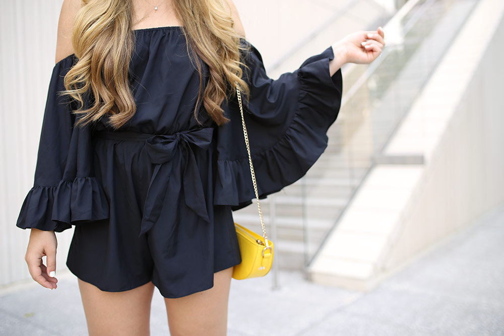 Black ruffled romper from Chicwish with off-the-shoulder neckline. Chicwish romper. Cute black romper with ruffles. Ruffled off-the-shoulder romper. Cute romper for summer. Cute black playsuit. Off-the-shoulder romper. Off-the-shoulder ruffled playsuit.