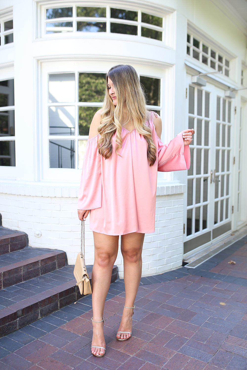 Feminine style with silky pink mini dress from Revolve. Feminine pink mini dress for date night. Sexy pink date night dress. Feminine pink mini dress.