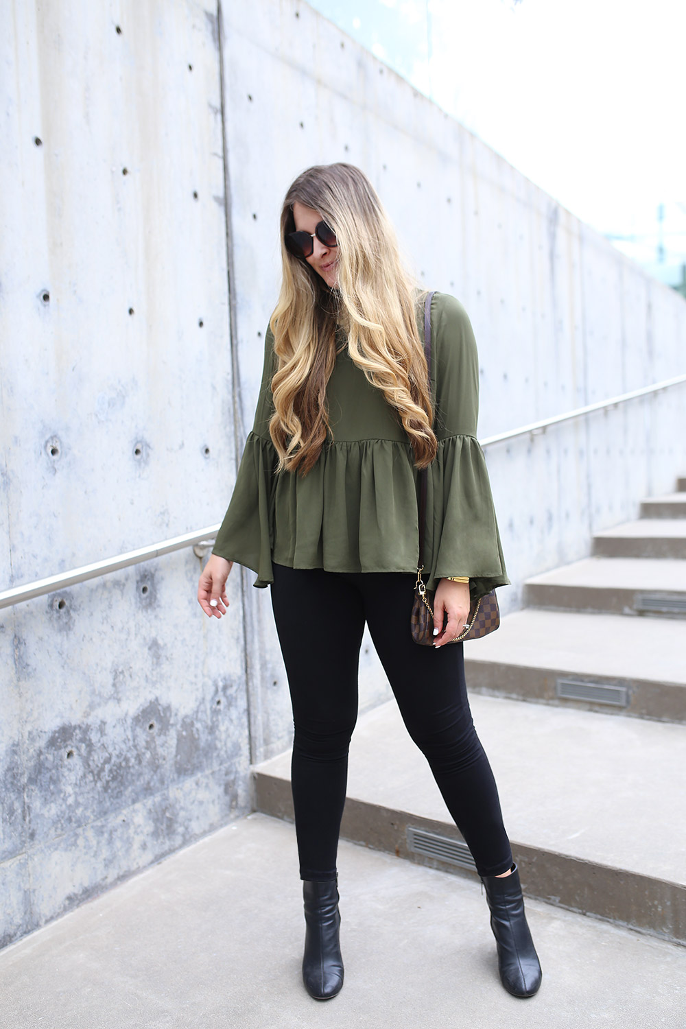 Versatile Olive Green Top for Fall from Asos for $72. Get ready for fall with this gorgeous bell sleeve top from Asos. It has a pretty, feminine silhouette with ruffles and dramatic sleeves. The olive green color is perfect for fall and can be dressed up or dressed down.  Pair it with lighter jeans and a pair of mules for running errands, strappy black heels and a sparkly bag for a spontaneous date night, and black cropped pants and pointy-toe pumps for the office. The options are endless with this top, and you will definitely get a ton of wear out of this top for $72.