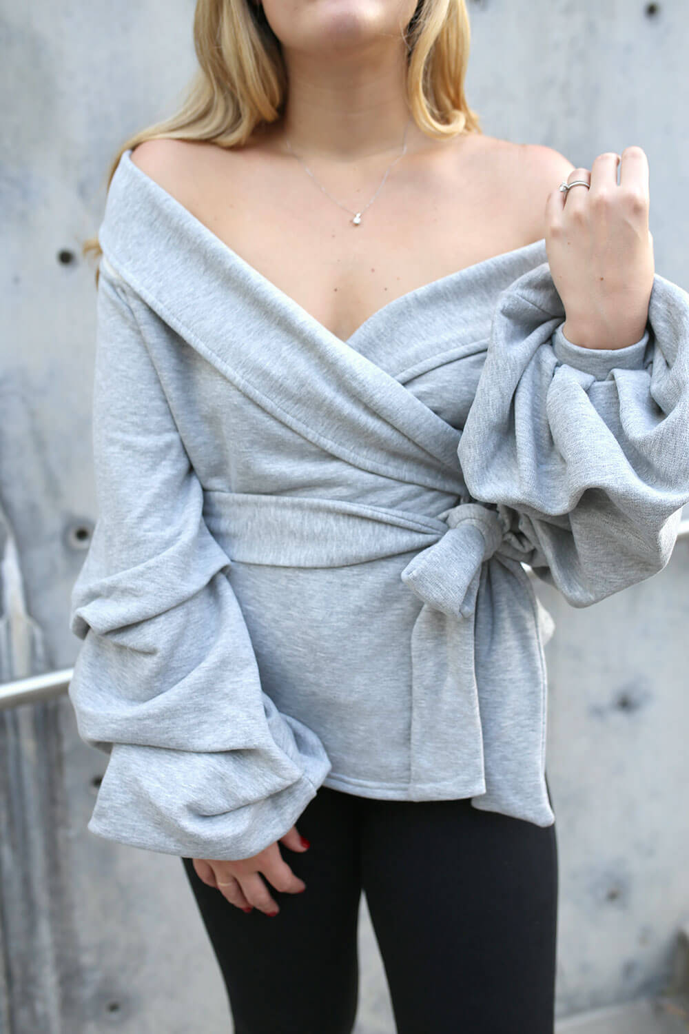 Dramatic sweater from Asos with layered ruffle sleeves in heather gray. This off-the-shoulder sweater is fashion-forward, chic, and street-style approved. Don't miss out on this incredible sweater from Asos. This is the perfect street style sweater for fall. Every girl needs a fashionable sweater for fall. Look chic this fall with this heather grey sweater from Asos.