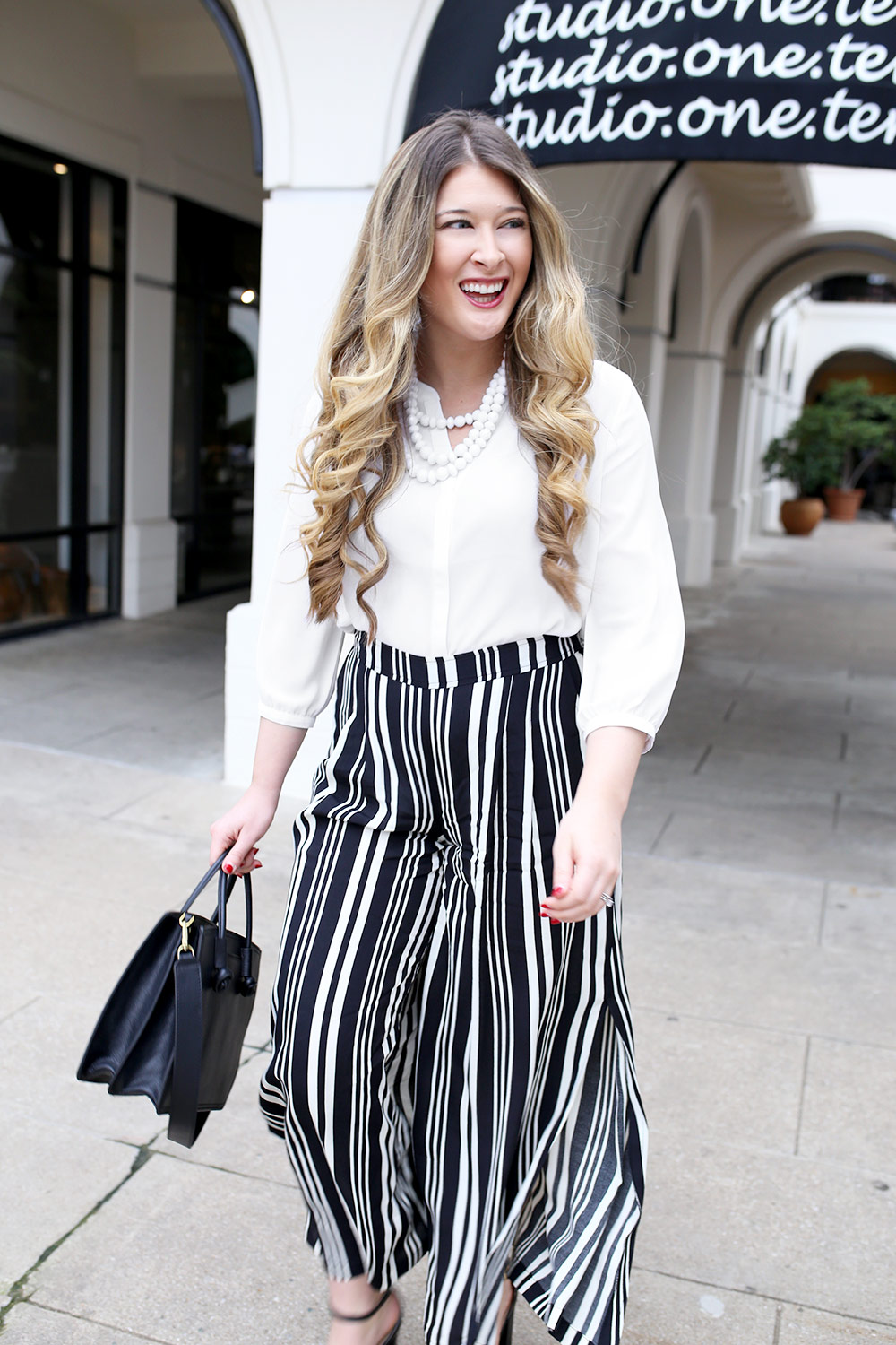 Workwear can start looking look all the same after awhile. I tend to stick to my basic black pants and skirt for the most part, but sometimes, it's fun to switch things up. These trendy striped wide-leg pants are perfect for an elegant business casual look with tons of personality.