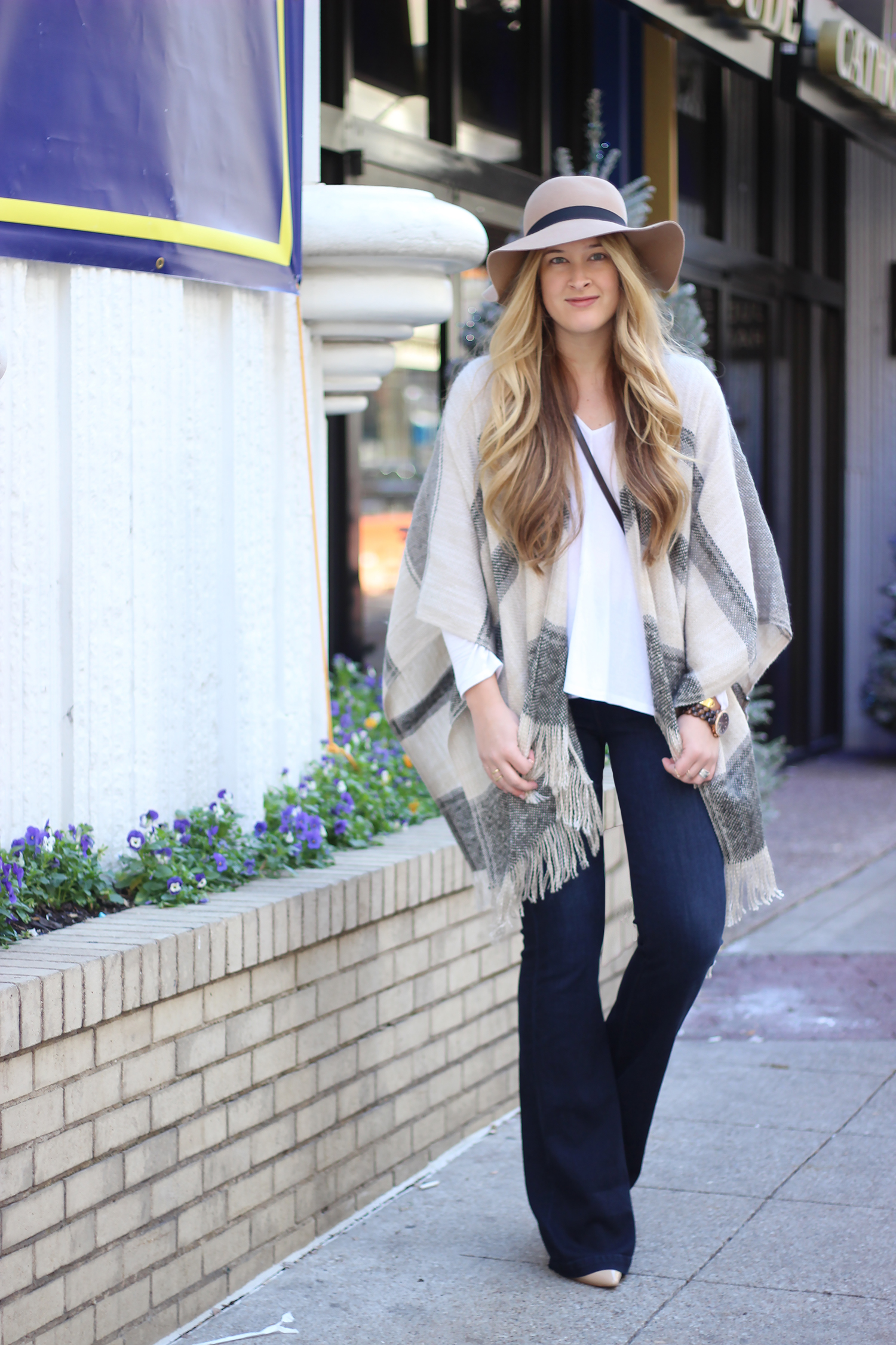 Fringe Poncho And Flared Jeans Cameron Proffitt