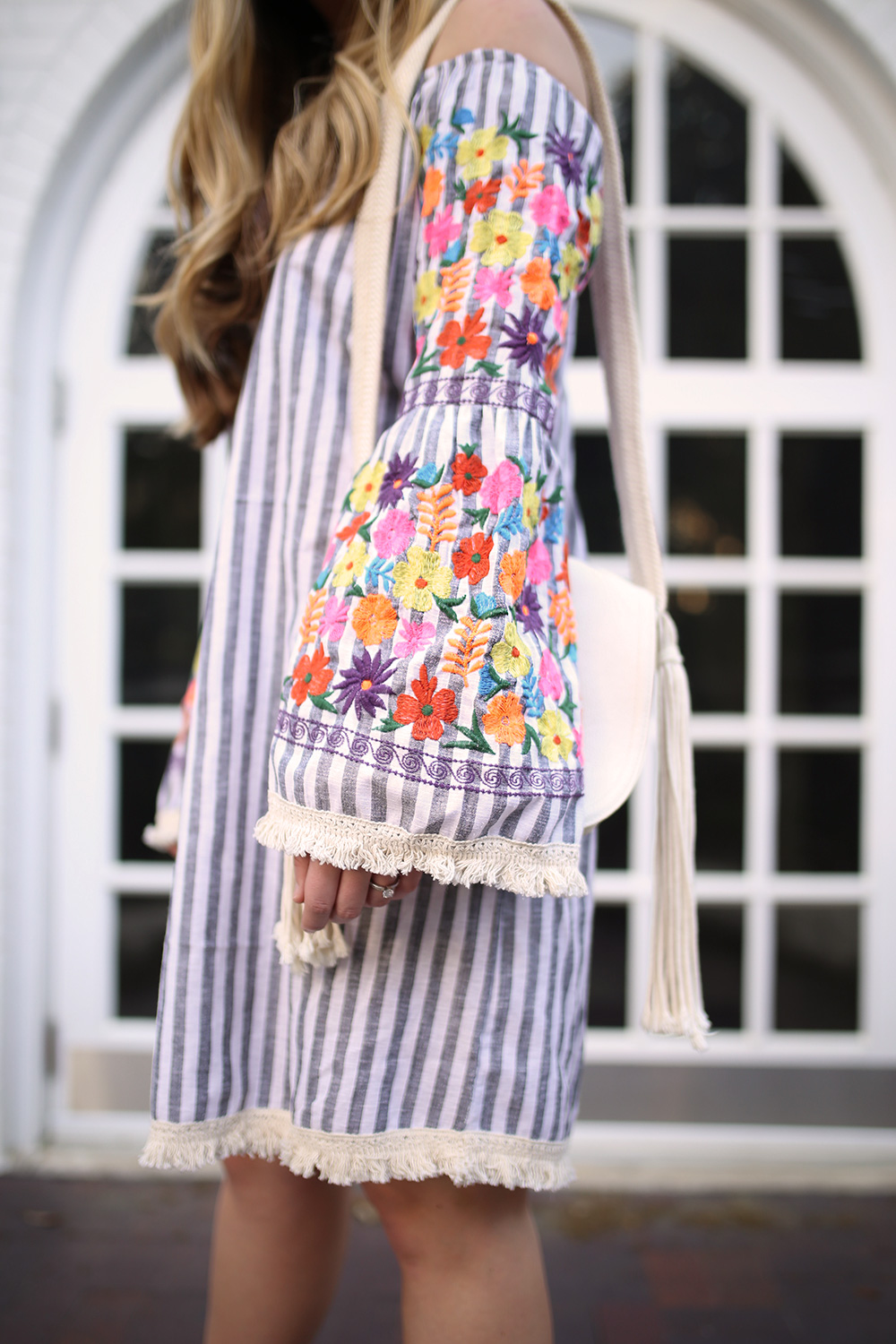 3820fe2f9 ... Dallas fashion blogger Cameron Proffitt wears embroidered bell sleeve  dress from asos ...